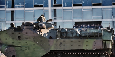 A tank drives past the Planalto Palace during a military parade in Brasilia, Brazil, on Tuesday, Aug. 10, 2021. Brazil's military staged an unusual convoy of troops and armored vehicles through the capital on Tuesday  an event announced only a day before and that coincided with a scheduled vote in Congress on one of President Jair Bolsonaro's key proposals, reported the Associated Press. Photographer: Gustavo Minas/Bloomberg via Getty Images