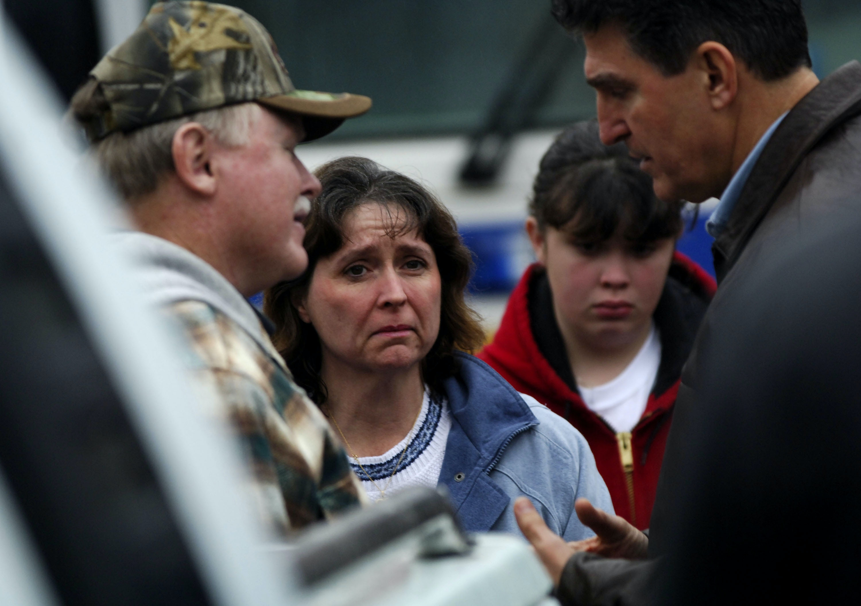 TALLMANSVILLE, WV -  JANUARY 3:  West Virginia Gov. Joe Manchin (R) speaks with residents about rescue operations at the Sago Mine January 3, 2006 in Tallmansville, West Virginia. Rescuers sped up efforts today to try to reach 13 miners who they have not been able to contact since an explosion yesterday cut off access to a two-mile shaft about 260 feet below the surface of the mine.  (Photo by Jeff Swensen/Getty Images)