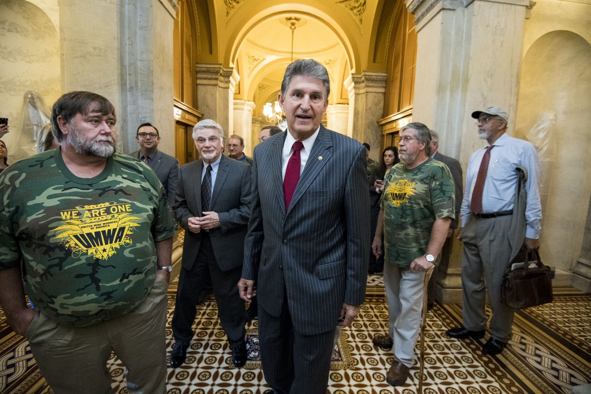 UNITED STATES - OCTOBER 3: Sen. Joe Manchin, D-W. Va.,  and United Mine Workers of America President Cecil Roberts arrive to hold a press conference on the introduction of the American Miners Pension Act (AMP Act) in the Capitol on Tuesday, Oct. 3, 2017. (Photo By Bill Clark/CQ Roll Call)