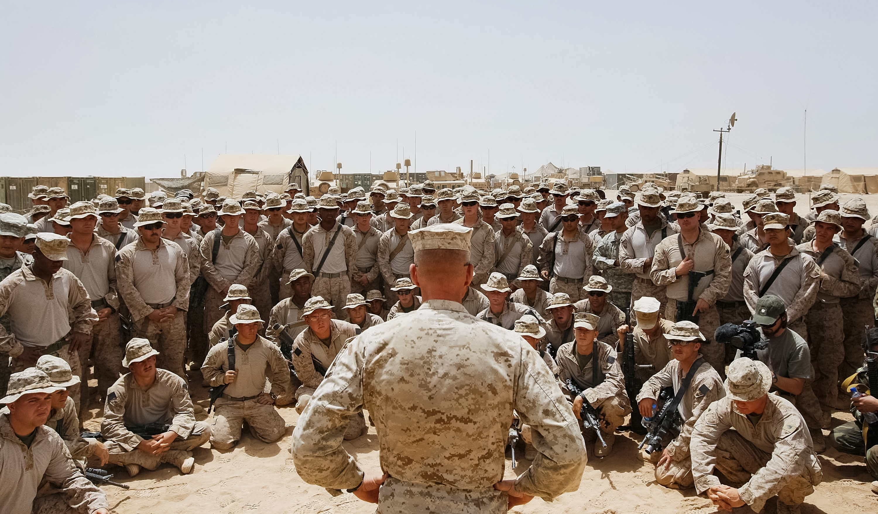 HELMAND PROVINCE- JULY 1: U.S. Lt. Col. Christian Cabaniss speaks to his Marines at Camp Dwyer on July 1, 2009 in Helmand Province, Afghanistan.The Marines are part of a stepped up effort by American troops fighting Taliban fighters in Southern Afghanistan. (Photo by Joe Raedle/Getty Images)