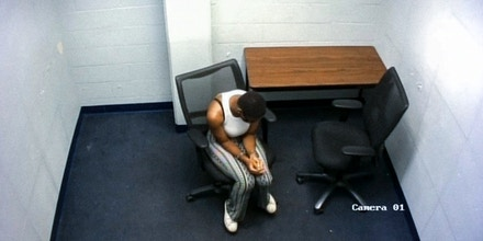 Surveillance video from inside the Mobile Police Department shows Tia Pugh sitting alone during an interrogation on June 2, 2020, in Mobile, Ala.