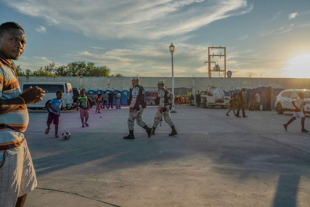 Children play as National Guard monitors the migrant shelter in Acuña, Mexico on Sept. 25, 2021.  Verónica G. Cárdenas for The Intercept