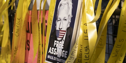 Supporters gather as England's High Court hears a U.S. appeal in the extradition case of WikiLeaks founder Julian Assange, on Aug. 11, 2021, in London.