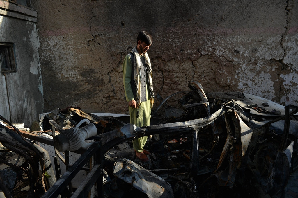 A neighbour of Ezmarai Ahmadi, stands amid the debris of Ahmadi's house that was damaged in a US drone strike in the Kwaja Burga neighbourhood of Kabul on September 18, 2021. - Ezmarai Ahmadi was wrongly identified as an Islamic State militant by US intelligence, who tracked his white Toyota for eight hours on August 29 before targeting the car, killing seven children and three adults. (Photo by Hoshang Hashimi / AFP) (Photo by HOSHANG HASHIMI/AFP via Getty Images)