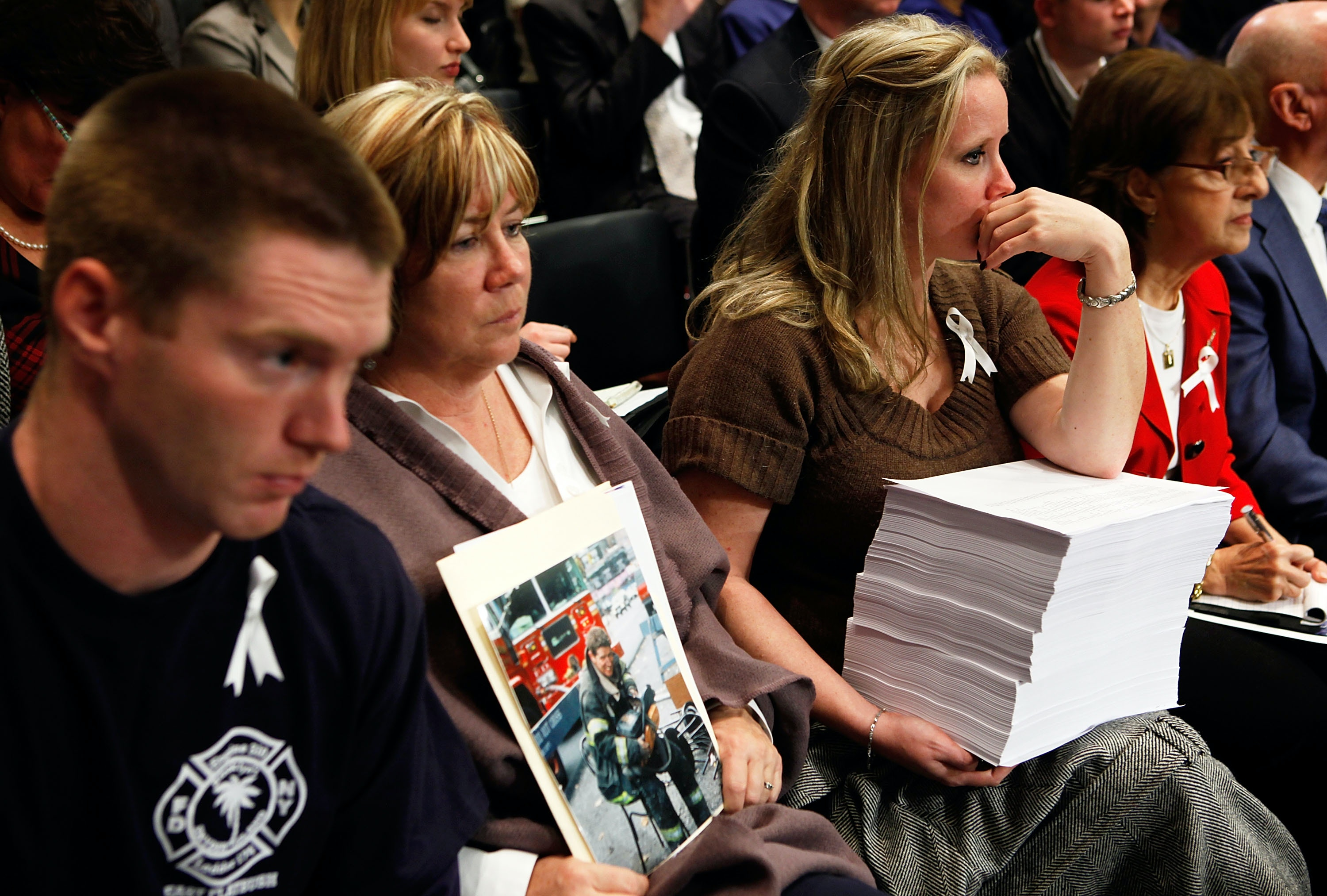 Theresa Regan (2nd L), who lost her husband and FDNY firefighter Donald Regan at the South Tower of the World Trade Center during the 9/11 terrorists attacks, listens with her son Peter (L) and daughterJill (3rd L) during a hearing before the Senate Judiciary Committee on Capitol Hill November 18, 2009 in Washington, DC.