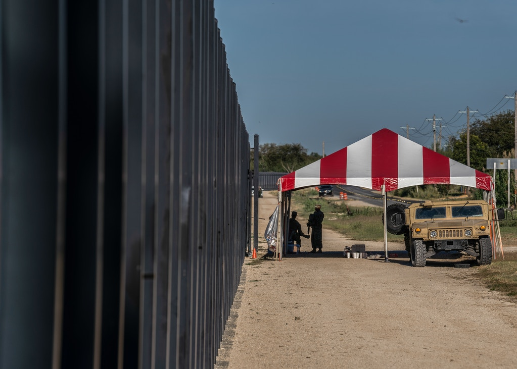 Members of the armed forces monitor an opening in the border wall near the Acuña - Del Rio International Bridge where it was estimated that there were 14,000 migrants at some point in Del Rio, Texas on Sept. 24, 2021.Verónica G. Cárdenas for The Intercept