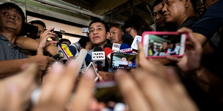 Philippine journalist Maria Ressa (C) gives a statement after posting bail at a regional trial court in Manila on February 14, 2019. - Ressa was freed on bail on February 14 following an arrest that sparked international censure and allegations she is being targeted over her news site's criticism of President Rodrigo Duterte. (Photo by Noel CELIS / AFP)        (Photo credit should read NOEL CELIS/AFP via Getty Images)