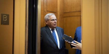 Sen. Bob Menendez, D-N.J., talks with reporters in an elevator as he makes his way to the Senate floor on July 13, 2021.