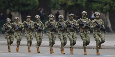 Mexican marines march during the Independence Day military parade at Zócalo Square on Sept. 16, 2020, in Mexico City.
