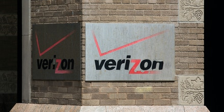 NEW YORK, NY - MAY 12:  A sign hangs on the Verizon headquarters on May 12, 2015 in New York City.  Verizon announced today that it is buying AOL for $4.4 billion.  (Photo by Andrew Burton/Getty Images)